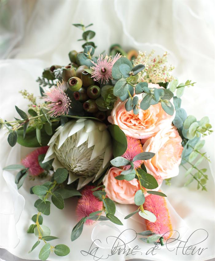 Bride\'s bouquet native flowers, protea, roses, flowering gum, bottle ...