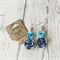 Delicate blue roses statement earrings