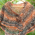 shoulder or hip wrap in mohair blend yarn with fibre brooch