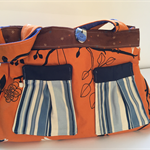 Orange bird print tote with brown blue and white detail and brushed denim lining