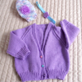 Size 6-12 months: Girls cardigan in purple with co-ordinated beanie and headband
