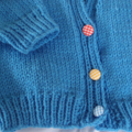 Size 6-12 months hand knitted cardigan in blue: unisex