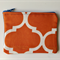 Orange and white geometric print denim purse with calico lining