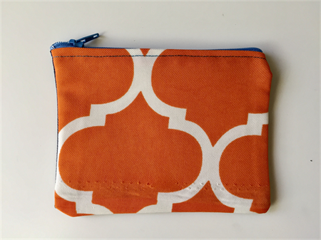 Orange and white geometric print denim purse with calico lining