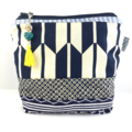Cosmetics / makeup bag with flower brooch and beaded tassel zipper- navy & red