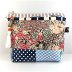 Cosmetics / makeup bag with flower brooch and beaded tassel- Balinese print