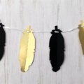 Feather Shape Banner. Black and Gold Party garland. Birthday party, baby shower.