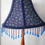 Blue flower fabric covered lampshade with blue beaded trim