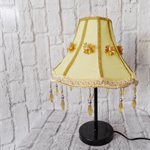 Beautiful marigold yellow lampshade with gold flowers and yellow beaded trim.