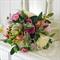 Bouquet of ornamental kale, coleus, dahlia, artichoke, eucalyptus foliage, rose.
