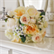 Bridal bouquet, cabbage roses, garden roses, jasmine, snowball, peony, peach.