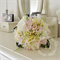 Bridesmaid bouquet of blushing bride, pincushion, wax flower, rose.