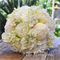 Bouquet of peony, peony buds, stock flowers, lily of the valley.