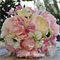 Bouquet of pink peony, white cabbage rose, white anemone, pink sweet pea,