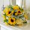 Bouquet of rose blooms, billy buttons, sun flower, jasmine, dusty miller.