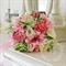 Bouquet of ranunculus, queen anne's lace, rose buds, calla lily, pittosporum