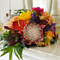 Bouquet of Palm leaves, peony, leaves, rhododendron, dahlia, king protea.