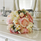 Bouquet of peony, apple blossom, succulent, cabbage rose.