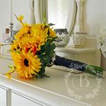 Bouquet of sunflowers, gerbera, forsythia, pittosporum, yellow dahlia, veronica