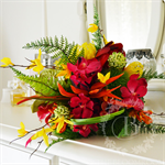 Bouquet of bird of paradise, pincushion, vanda orchid, calla lilies, forsythia.