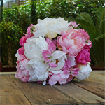 Bouquet of white, light pink, hot pink, peony, sweet pea.