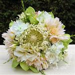 Bridesmaid bouquet of blushing bride, stock, pincushion, wax flower, rose.