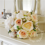 Bouquet of cabbage rose, peony, garden roses and mini roses with jasmine