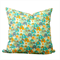 Elephant print cushion in teal, green and oranges