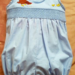 Blue and white checked play suit/romper with smocking & embroidered hen/chicks