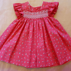 Smocked dress with butterfly sleeve, red with white spots/roses. Size 18 months