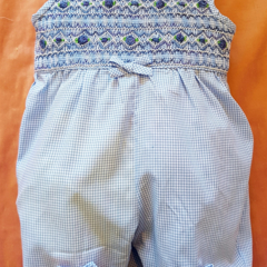 Pale blue gingham smocked play suit/romper with bullion roses. Size 12 months