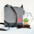 Medium size 'Jodi' bag. Black vinyl, light grey fabric with feature red bird.