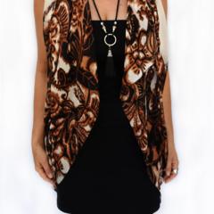Silk scarf, sarong, bandana, shawl, vest. A stylish cover-up.