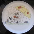 Hand painted plate featuring a dog, umbrella and blue bird