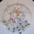 Hand painted plate featuring 2 rabbits and flowers