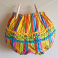 Fancy Pants, multicoloured stripes with little ruffles. Size 2
