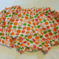 Fancy Pants with three ruffles.  Orange print fabric. Size 12 months.