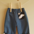 Little Hipster Pants with cuff and pocket. Cuff in black cow print-size 9 months