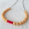 Silicone teething necklace: scarlet and gold