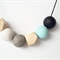Black, stone and mint necklace with geometric wooden beads on black cord