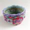Unique round embellished felt bowl.