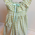 Green and blue floral dress with ruffle neck line and pocket. Size 3-4