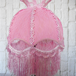 Beautiful ballerina pink lampshade with lace overlay and tassel fringe.