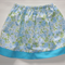 Girls skirt - blue floral with plain trim - size 3