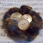Crocheted hair clip made from mohair blend yarn and vintage buttons