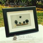 Handmade pebble craft behind glass