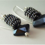 Coiled wire, navy/silver, gunmetal blue faceted glass bead