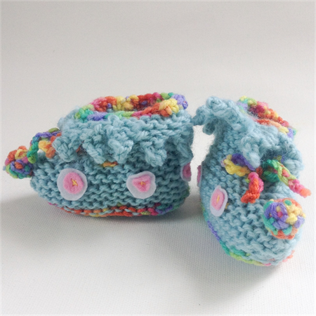Unique embellished knit baby booties for 0 - 3 months.