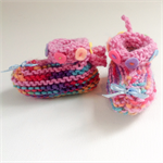 Unique embellished knit baby girl booties. Newborn to 3 months.