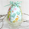 Fabric Covered Easter Egg sitting in a wood fibre and  glass nest